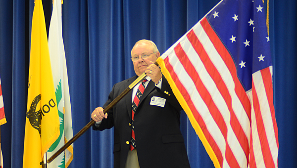 Howard Prater, a member of the Cahaba Valley Elks Lodge, presents the 15-star flag during an Oct. 1 presentation at Meadow View Elementary School. (Reporter Photo/Neal Wagner)