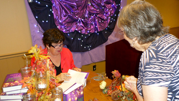 Best-selling author Mary Kay Andrews signs books after a luncheon at the Pelham Public Library on Oct. 7. (Reporter Photo / Molly Davidson)