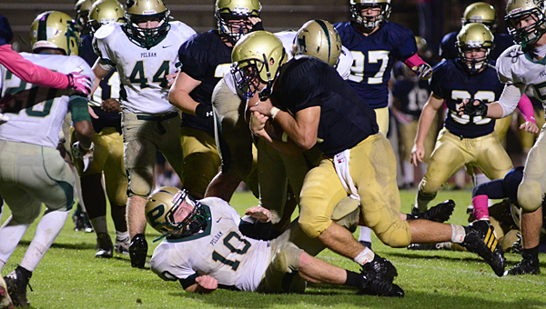 Briarwood quarterback Walker Lott runs over Pelham's Chase Shearer (10) during the Lions 31-19 win over the Panthers on Oct. 10. (Reporter Photo/Neal Wagner)