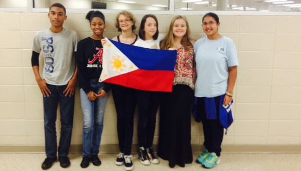 RMS JUNA student delegates hold up the flag of the Philippines. From left to right, Marcellous Washington, Tramaine Moore, Elise Hansen, Aleah Hayes, Hope Love and Arshnoor Grewal. (Contributed)