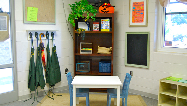 Several members of the Valley Intermediate School community donated their time and talents to redecorate the school's front office. (Reporter Photo / Molly Davidson)