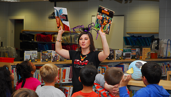 MVES library media specialist Christina Tomlin displays books available to children at MVES on Oct. 31. (Reporter Photo/Neal Wagner)