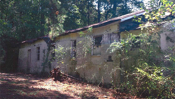 Alabaster likely will demolish an abandoned, overgrown church on Simmsville Road. (Contributed)