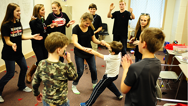 Thompson Middle School students dance with their peers at the Warrior Center for special needs children on Oct. 24. (Reporter Photo/Jon Goering)