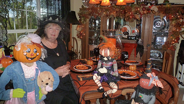 Leigh Ann Langley, sitting in her breakfast room with one of her Pumpkin Patch Kids, will open her home for a Halloween Open House Saturday, Oct. 25, from 5:30-8:30 p.m. to benefit the Columbiana Merchants and Professionals Association Scholarship Fund. Tickets are $10 donation to CMPA Scholarship Fund. (Contributed)