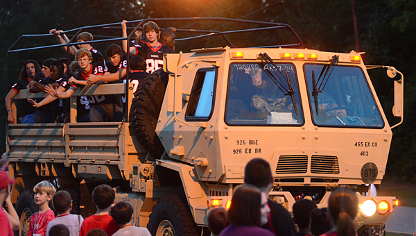 Members of the Thompson High School football team ride on a military transport vehicle during the Alabaster homecoming parade on Oct. 8. (Reporter Photo/Neal Wagner)