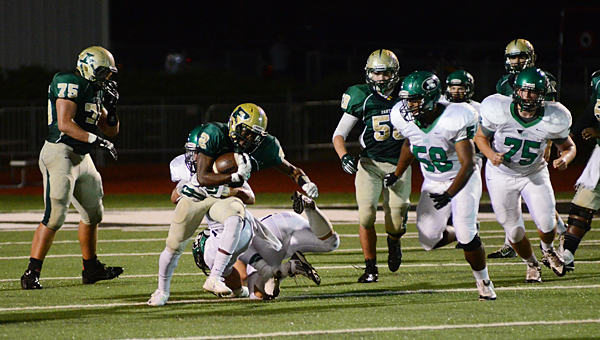 Pelham's Giovanny Adan (22) sprints for a first down during the Panthers' 27-14 loss to Hueytown on Oct. 3. (Reporter Photo/Neal Wagner)
