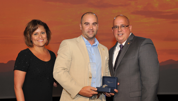 Inverness Longhorn Steakhouse manager Jeff Fulton, center, receives the Best of the West Award. (Contributed)