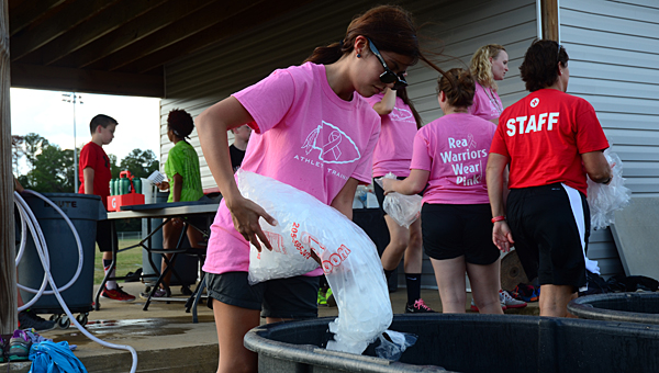 THS athletic trainer Stephania Cosas prepares an ice bath for some of the school's student athletes on Oct. 7. (Reporter Photo/Neal Wagner)