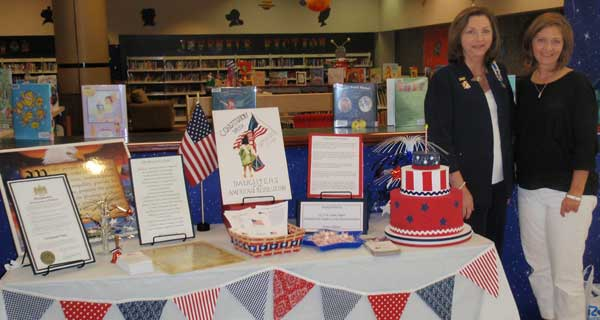 Kaye Sutley and Tracy Pflaum, members of the Lily of the Cahaba Chapter of the Daughters of the American Revolution, staff a Constitution Week display at the North Shelby County Library.   (Contributed photo.)