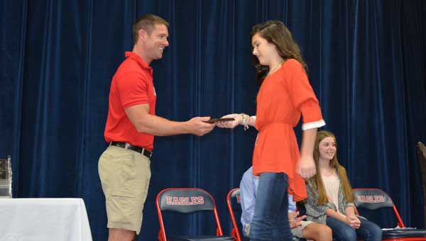 Character with Character recipient Emma Grace Ingram receives her award from Noah Galloway.