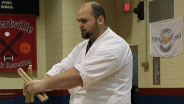 Tony Frederick instructs his students on how to properly use nunchucks. (Contributed/Joe Antonio)