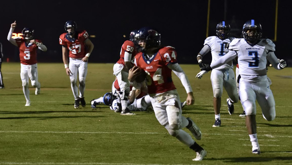 Oak Mountain's Harold Shader breaks away from the James Clemens defense as teammates celebrate in a comeback win in the first round of the AHSAA Class 7A playoffs. (Contributed/Barry W. Clemmons)