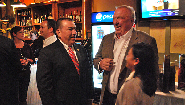 New Shelby County Sheriff John Samaniego and Columbiana Mayor Stancil Handley share a laugh Tuesday, Nov. 4 at Samaniego's election results watch party at Bernie's restaurant in Columbiana. (Reporter Photo/Graham Brooks)
