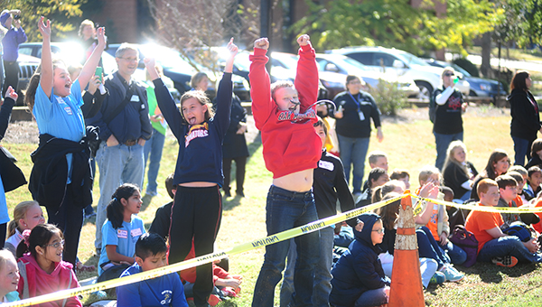 Students cheer as their contraption they constructed kept an egg from breaking during the egg drop competition at the Science Festival on Friday, Nov. 7. (Reporter Photo/Jon Goering)