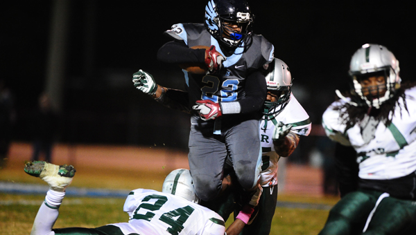 Calera running back ShaKeith Tyes breaks tackles in a playoff win over Vigor on Nov. 7. (Reporter Photo/Jon Goering)