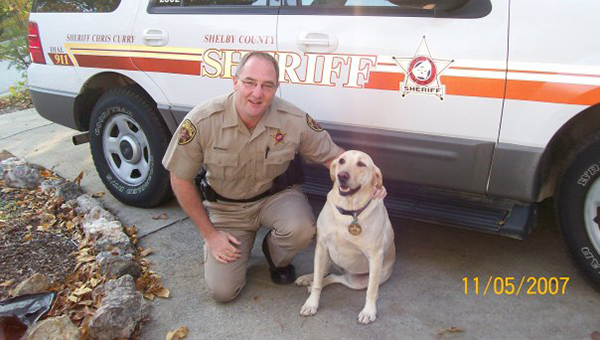 Deputy Allan Morgan was Shelby's handler from 2003 to 2010 at the Shelby County Sheriff's Office. Shelby recently passed away at the age of 12. (Contributed)
