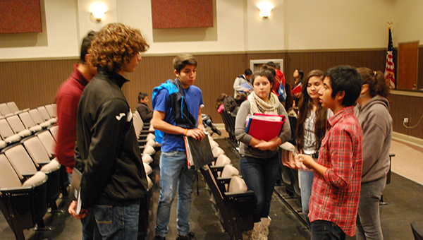 Victor Cuicahua, right, answers questions from MHS ESL students after giving a speech on Wednesday, Nov. 12 where he discussed how successful you can be if you put your mind to it. (Reporter Photo/Graham Brooks)