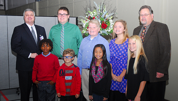 From left, Alabaster School Superintendent Dr. Wayne Vickers, A.J. Crear, Michael Giddens, Colby Prosser, Noah Tanner, Ana Claire Young, Maggie O'Neal, Lindsey Cook and Judge Jim Kramer. (Reporter Photo/Neal Wagner)