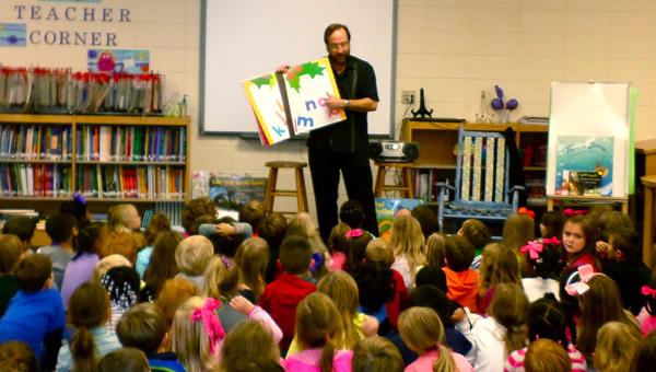 "Chicka chicka boom boomAward-winning author John Archambault reads his book ""Chicka Chicka Boom Boom"" to Helena Elementary School kindergarten students during a Nov. 17 presentation. (Reporter Photo / Molly Davidson)"