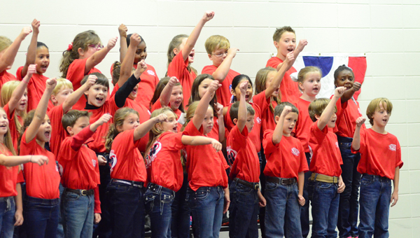 Members of the Creek View Elementary School third-grade choir perform for their classmates during a Nov. 7 Veterans Day ceremony. (Reporter Photo/Neal Wagner)
