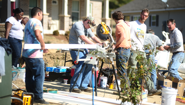A group of Pelham High School students volunteered their day off to build with Habitat for Humanity on Veterans Day. (Reporter Photo / Jon Goering)