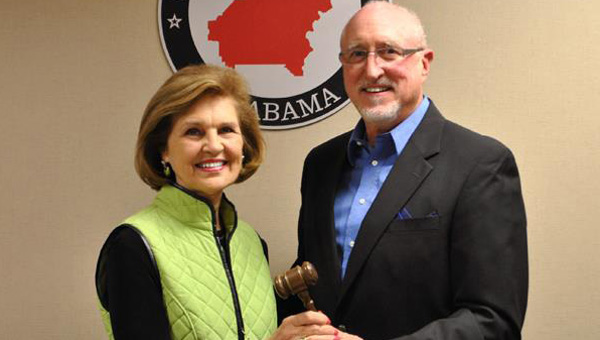 Former SCGOP Chairman Freddy Ard passes the gavel to new SCGOP Chairman Joan Reynolds. (Contributed)