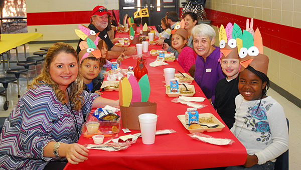 Students in Creek View Elementary School third-grade teacher Hayley Medina's class and their parents enjoy Thanksgiving lunch at the school on Nov. 19. (Reporter Photo/Neal Wagner)
