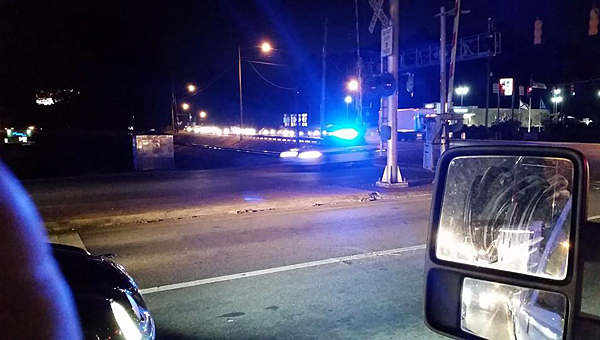 Several police and Sheriff's Office vehicles chase Matthew Oakes' vehicle near the intersection of Alabama 119 and U.S. 31 in Alabaster on the night of Nov. 25, 2014. (File)