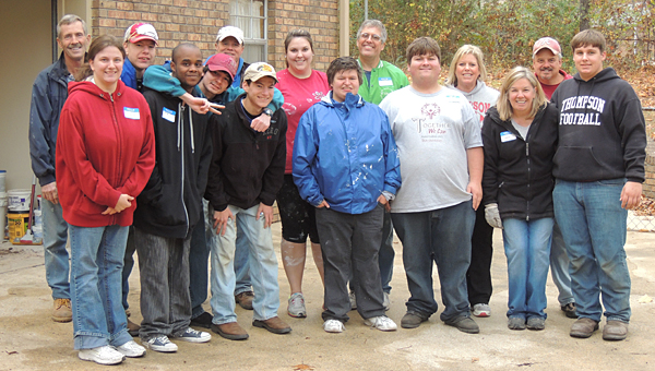 Local realtor Sonia Coleman, third from right, helps Project SEARCH members with a Habitat for Humanity build in November 2013. (Contributed)