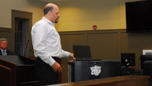 Alabaster City Schools Technology Coordinator Keith Price showcases a mobile laptop cart during a Nov. 10 School Board meeting. (Reporter Photo/Neal Wagner)