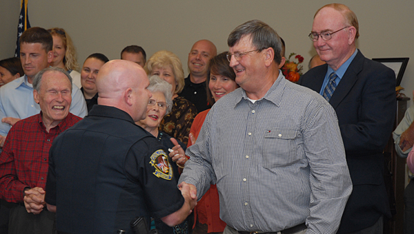 Stanley Oliver, second from right, during his 2012 retirement party at the Alabaster Senior Center. Oliver is now battling a rare lung disease. (Reporter Photo/Neal Wagner)