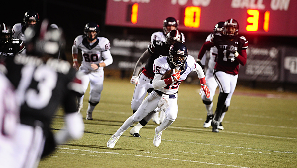Oak Mountain's Evan Benison (15) sprints for a first down during the Eagles' 45-28 loss to Gadsden City in the second round of the 7A playoffs on Nov. 14. (Reporter Photo/Jon Goering)