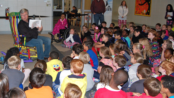 Helena Mayor Mark Hall reads to Helena Intermediate School students during an Oct. 31 school-wide reading celebration. (Reporter Photo / Molly Davidson)
