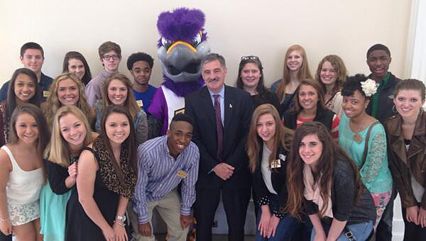 The Youth Leadership Shelby County Class of 2015 poses with University of Montevallo President Dr. John Stewart and mascot Freddie the Falcon. (Contributed)