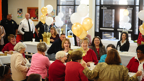 Former MES teachers laugh at old stories told during a celebratory breakfast held for MES to celebrate the school's 50th birthday. (Reporter Photo/Jon Goering)