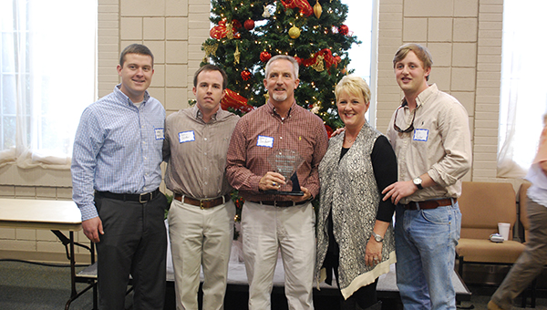 Members of Snider's Pharmacy and Ground Up Coffee and Smoothies received the 2014 business of the year award from the South Shelby Chamber of Commerce at the Diamond Awards Luncheon on Thursday, Dec. 4. (Reporter Photo/Graham Brooks)