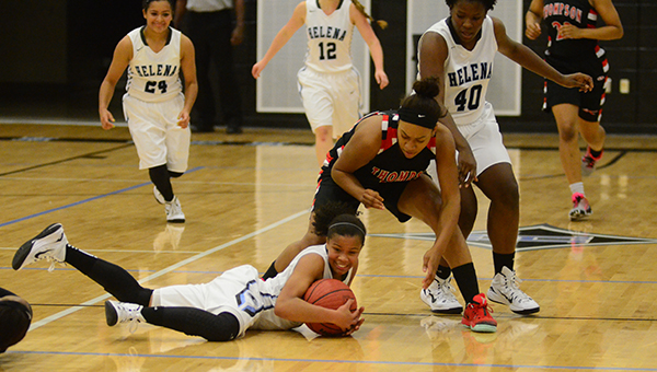 The Lady Warriors defensive pressure was relentless all night as players battle for a loose ball. Thompson defeated Helena 56-5 on Tuesday, Dec. 9. (Reporter Photo/Graham Brooks)