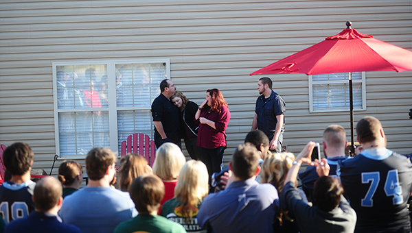 The Sissel family reacts for the first time after seeing their brand new patio before the filming of the commercial was done. (Reporter Photo/Jon Goering)