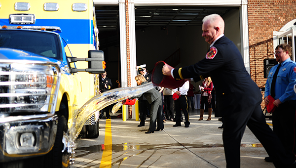 Participants at the ceremony take part in the wet down of the apparatus. The ceremony took place at the Montevallo Fire Department Station 2 on Sunday, Dec. 7. (Reporter Photo/Jon Goering)