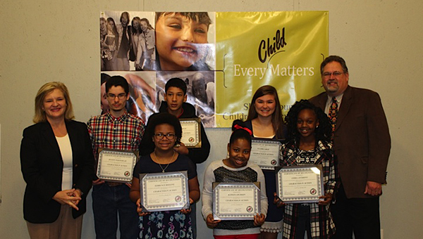 From left to right: Jill Lee (District Attorney), Dustin Whitehead (VMHS), Josh Thomas (VMHS), Amari Riggins (VES), Kamaya Hudson (MES), Claire Gray (MHS), Lydia Anthony (MMS), and Judge Kramer. (Contributed)