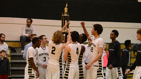 Pelham players hoist the Shelby County Tournament trophy. The Panthers defeated the Thompson Warriors 60-55 on Saturday, Dec. 20 to win the championship. (Reporter Photo/Graham Brooks)