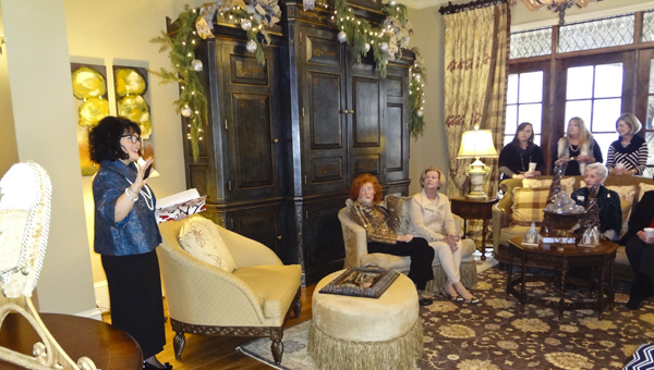 Hannah Home Shelby Auxiliary President Tamara Moser (left) talks to members at a Christmas party Dec. 18. (Reporter Photo/Emily Sparacino)