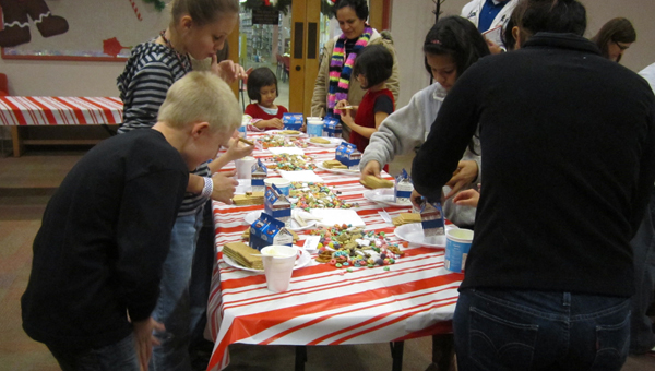 Children decorate gingerbread houses at Albert L. Scott Library on Dec. 9. (Contributed / Ginny Cooper McCarley)