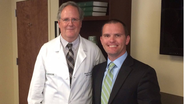Dustin Chandler, right, with chair of the UAB Neurology Department Dr. David Standaert, left. UAB is leading a study of possible benefits of CBD oil in the treatment of seizure disorders, which could begin in February. (Contributed)
