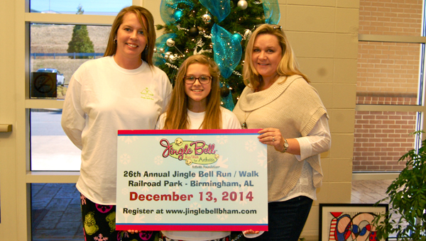Meredith George, Anna Grace McDonald and HMS Assistant Principal Jennifer Cofer celebrate a pajama day to raise money for Anna's Angels Jingle Bell Walk/Run for Arthritis team. (Reporter Photo / Molly Davidson)