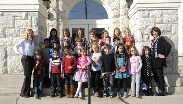 A group of students from Hilltop Montessori School visited the Shelby County Reporter office in Columbiana on Dec. 4 to learn how newspapers are put together.