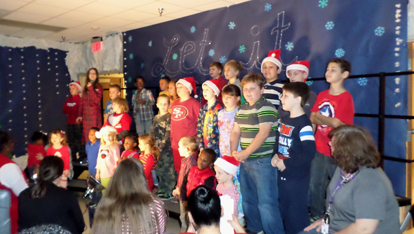 """The student choir sang popular Christmas carols at the Dec. 17 performance of the Linda Nolen Learning Center's """"Snowmen at Christmas."""" (Reporter Photo / Molly Davidson)"""