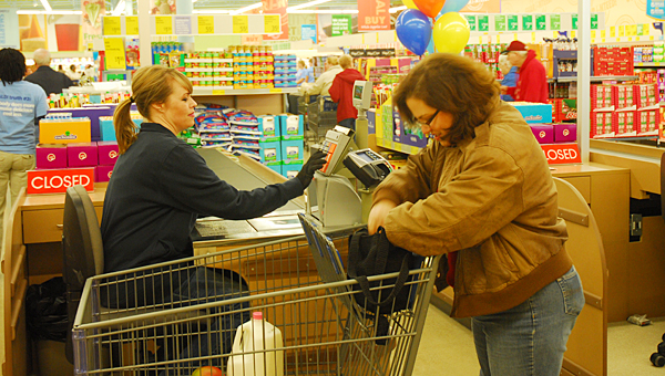 Laura Ralph, right, was the first person to check out at the new Alabaster Aldi grocery store, which opened its doors on Dec. 17. (Reporter Photo/Neal Wagner)