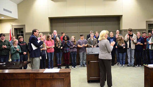 Alabaster Mayor Marty Handlon, center, applauds members of the Thompson High School wind ensemble for being selected for a prestigious national festival. (File)